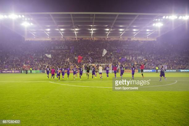Orlando City players run to meet their fans after winning the soccer match between the Orlando City Lions and the Philadelphia Union on March 18 2017...