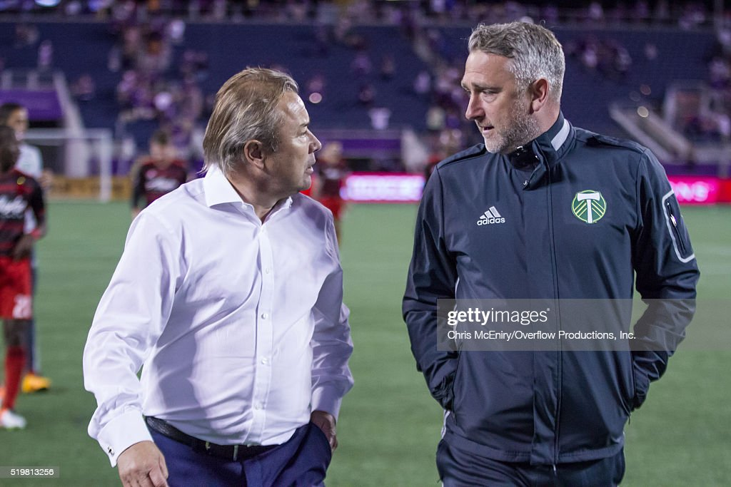 Orlando City SC coach Adrian Heath and Portland Timbers assistant coach Sean McAuley chat at Citrus Bowl on April 3, 2016 in Orlando, Florida.