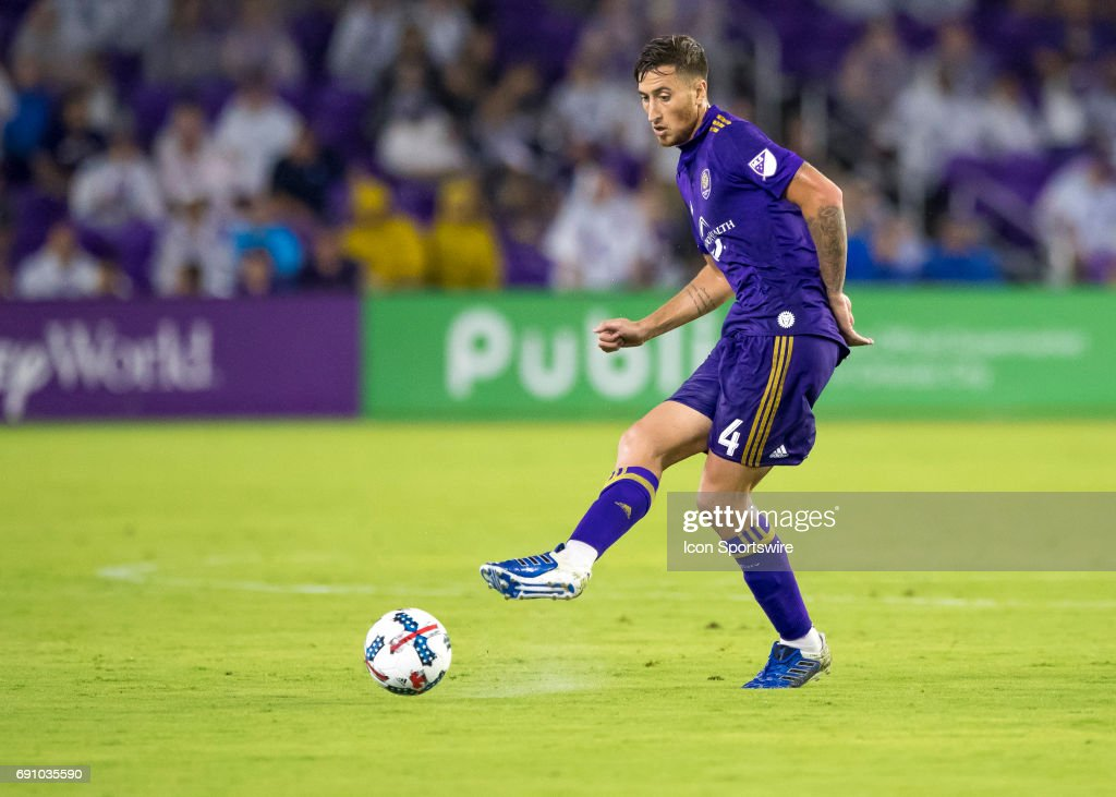 Orlando City SC defender Jose Aja (4) passes the ball During the MLS soccer match between the Orlando City FC and the DC United on May 31st, 2017, at Orlando City Stadium in Orlando FL.