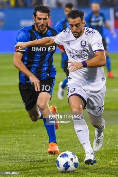 Orlando City SC defender RJ Allen tries to block Montreal Impact midfielder Ignacio Piatti while keeping control of the ball during the Orlando City...