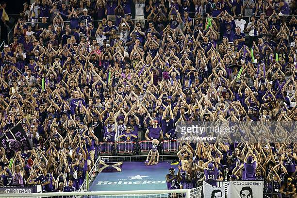 Orlando City SC fans chant and clap during an MLS soccer match between Toronto FC and the Orlando City SC at the Orlando Citrus Bowl on April 26 2015...
