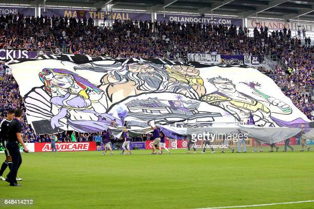 Orlando City SC fans display a large painted Tifo during a MLS soccer match between New York City FC and Orlando City SC at the Orlando City Stadium...