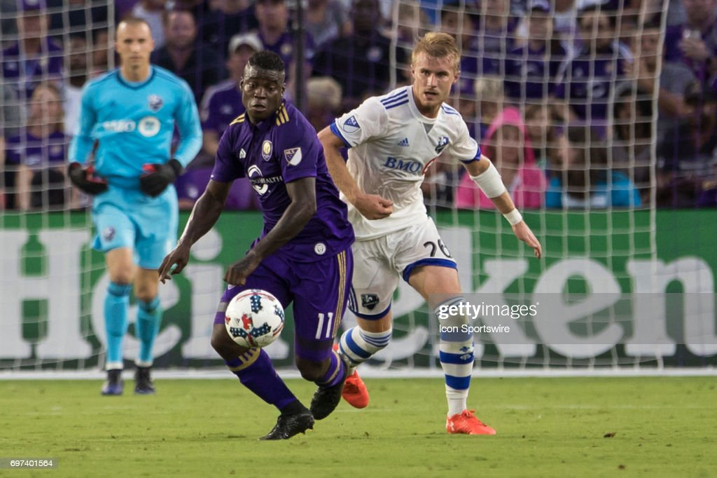 Orlando City SC forward Carlos Rivas (11) and Montreal Impact defender Kyle Fisher (26) go for the ball during the MLS soccer match between the Montreal Impact and Orlando City on June 17, 2017 at Orlando City Stadium in Orlando FL.