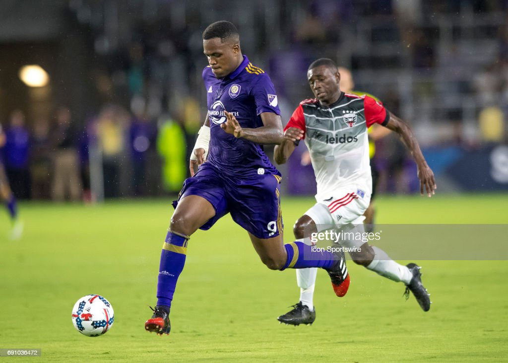 Orlando City SC forward Cyle Larin (9) brings the ball up field During the MLS soccer match between the Orlando City FC and the DC United on May 31st, 2017, at Orlando City Stadium in Orlando FL.