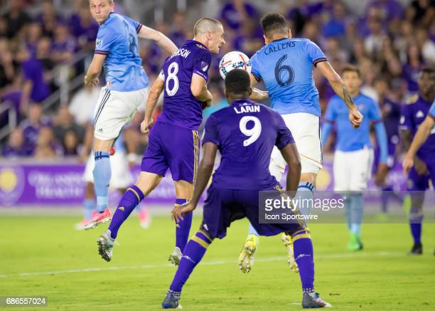 Orlando City SC forward Will Johnson and New York City FC defender Alexander Callens challenge for a headder During the MLS soccer match between the...