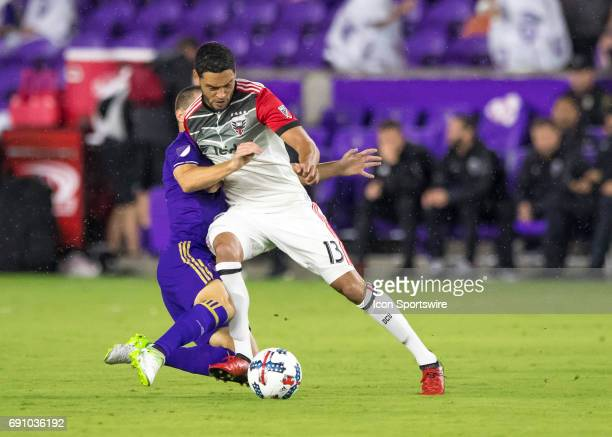 Orlando City SC forward Will Johnson slide tackles DC United midfielder Lamar Neagle During the MLS soccer match between the Orlando City FC and the...