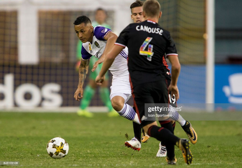 Orlando City SC forward Yoshimar Yotun (19) slips past D.C. United midefielder Zoltan Sieber (19) and defender Russell Canouse (4) during a MLS match between D.C United and Orlando City SC on September 9, 2017, at RFK Stadium in Washington D.C. Orlando City defeated D.C. United 2-1.