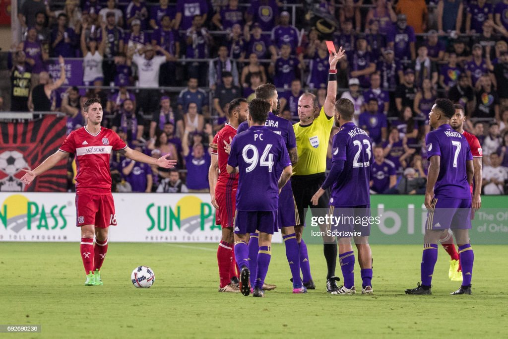 Orlando City SC midfielder Antonio Nocerino (23) is issued a red card by head official Ted Unkel during the soccer match between the Chicago Fire and Orlando City on June 4, 2017 at Orlando City Stadium in Orlando FL.