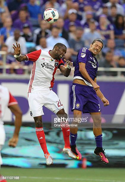 Orlando City's Adrian Winter right and the San Jose Earthquake's Shaun Francis go up for a header in the first half at Camping World Stadium in...