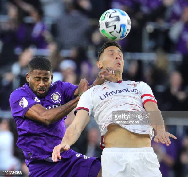 Orlando City's Ruan left and Real Salt Lake's Damir Kreilach collide on a header at Exploria Stadium in Orlando Fla on Saturday February 29 2020 The...
