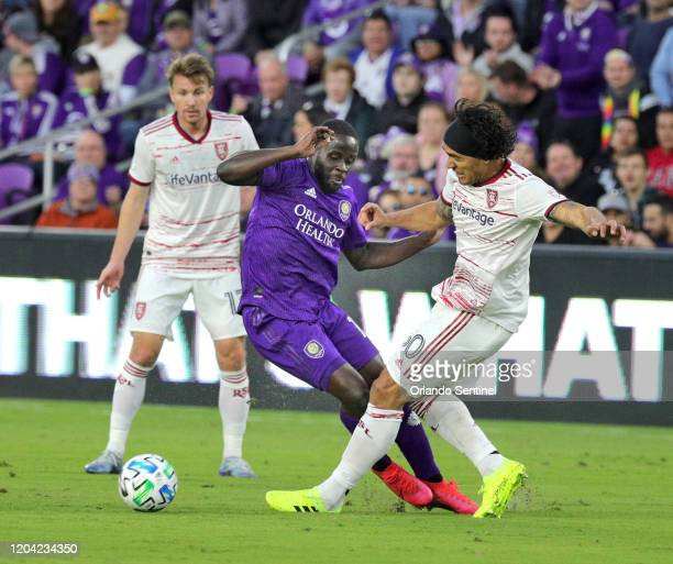 Orlando City's Tesho Akindele middle and Real Salt Lake's Marcelo Silver right battle for ball at Exploria Stadium in Orlando Fla on Saturday...