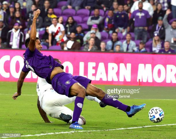 Orlando City's Tesho Akindele top gets tripped up on a shot attempt against Real Salt Lake at Exploria Stadium in Orlando Fla on Saturday February 29...