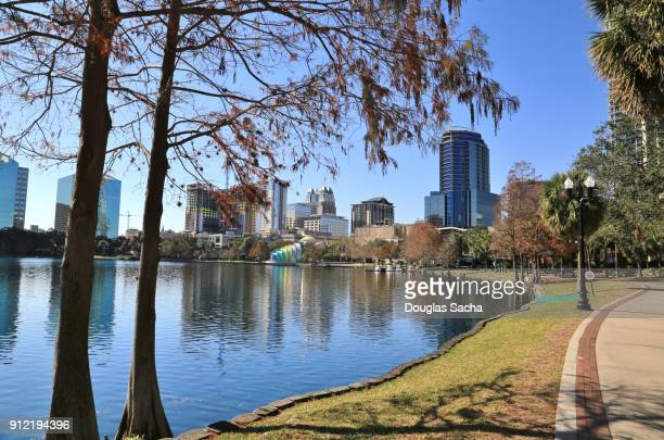 orlando downtown skyline from lake eola park - orlando florida stock photos and pictures