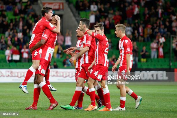 Orlando Engelaar embraces Heart team mate Harry Kewell after scoring a goal during the round 27 ALeague match between Melbourne Heart and the Western...