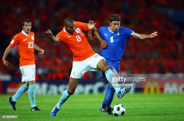Orlando Engelaar of Netherlands and Andrea Barzagli of Italy battle for the ball during the Euro 2008 Group C match between Netherlands and Italy at...