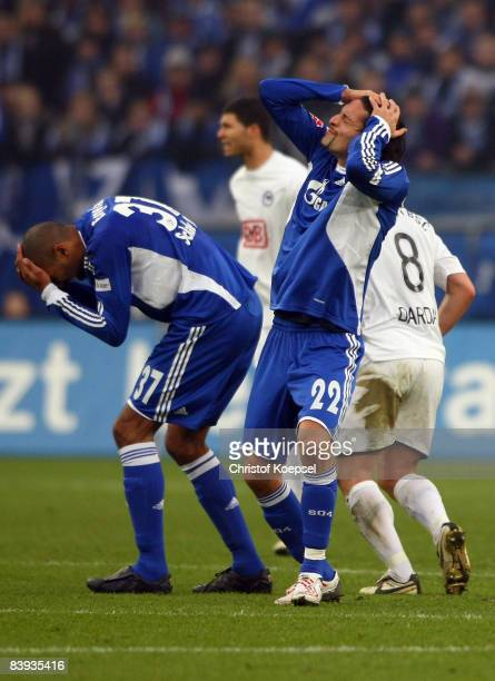 Orlando Engelaar of Schalke and Kevin Kuranyi of Schalke have knocked together after an tackling during the Bundesliga match between FC Schalke 04...