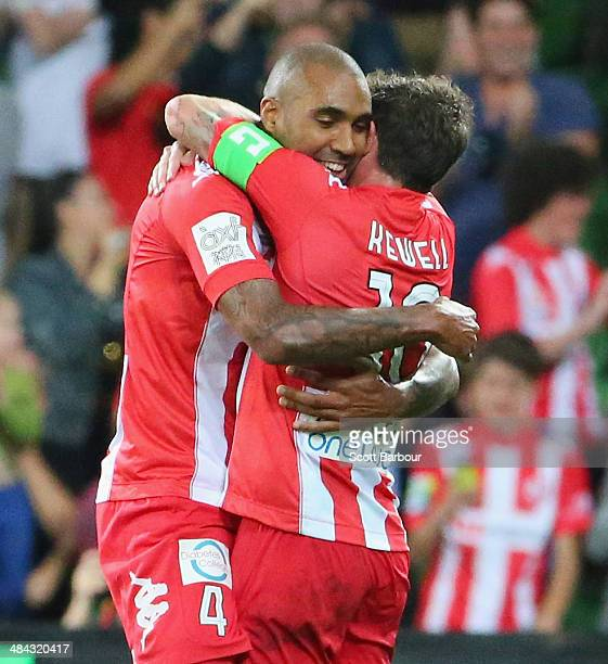 Orlando Engelaar of the Heart celebrates after scoring a goal by embracing Harry Kewell of the Heart during the round 27 ALeague match between...