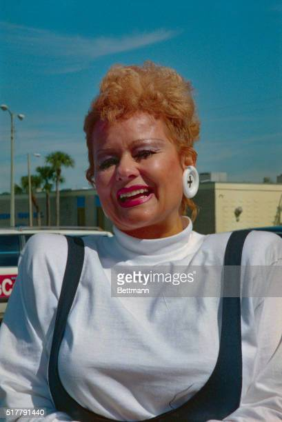 Tammy Faye Bakker has a broad smile as she meets with the media outside her church Tammy said her husband Jim Bakker was teaching a no smoking class...
