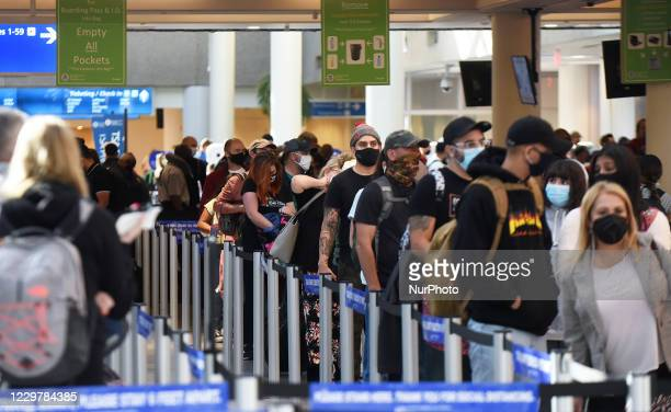 Orlando, Florida, United States - People wait in line at a TSA security checkpoint at Orlando International Airport on Thanksgiving eve, November 25...
