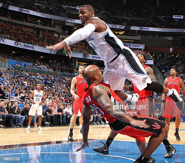 Orlando forward Glen Davis commits and offensive foul on Toronto guard Anthony Carter during the first half of the Magic's game against the Raptors...