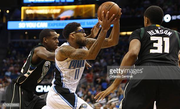 Orlando guard Devyn Marble drives against Milwaukee forwards Khris Middleton and John Henson on Monday, April 11 at the Amway Center in Orlando, Fla.