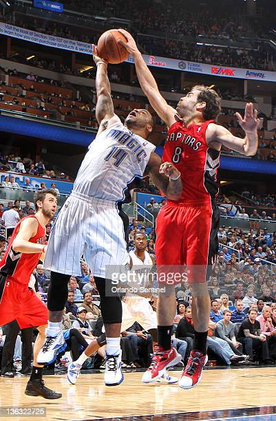 Orlando guard Jameer Nelson has his shot blocked by Toronto guard Jose Calderon during the first half of the Magic's game against the Raptors at...