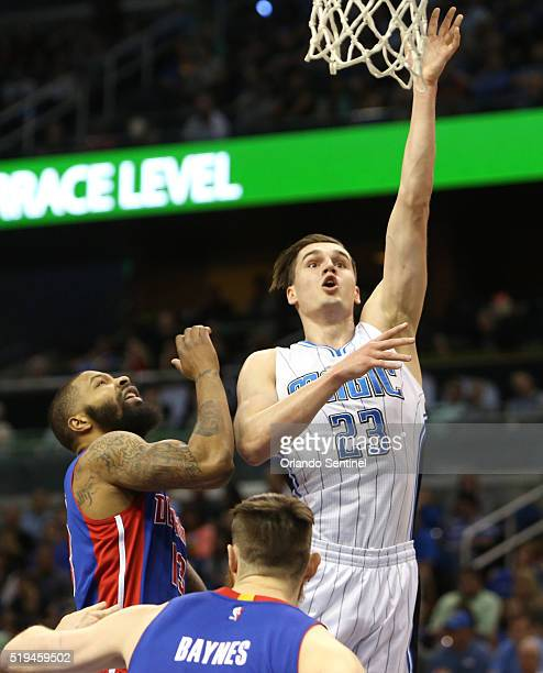 Orlando guard Mario Hezonja attempts a shot over Detroit forward Marcus Morris and center Aron Baynes on Wednesday April 6 at the Amway Center in...