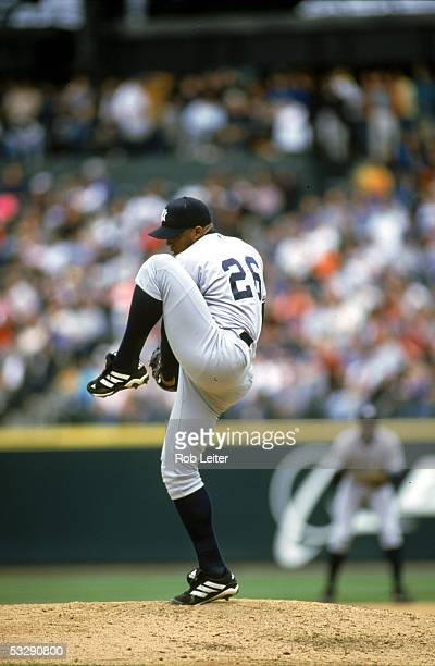 Orlando Hernandez of the New York Yankees pitches during an MLB game Orlando El Duque Hernandez played for the New York Yankees from 199802 and...