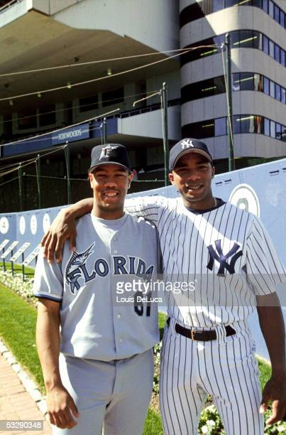 Orlando Hernandez of the New York Yankees poses with his half brother Livan Hernandez of the Florida Marlins at Yankee Stadium in the Bronx New York...