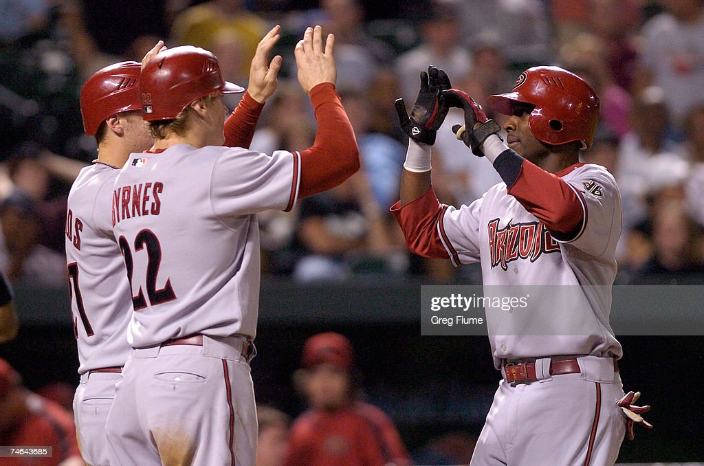 Orlando Hudson #1 of the Arizona Diamondbacks is congratulated by Eric Byrnes #22 and Mark Reynolds #27 after hitting a pinch-hit home run in the eighth inning against the Baltimore Orioles at Camden Yards June 15, 2007 in Baltimore, Maryland.