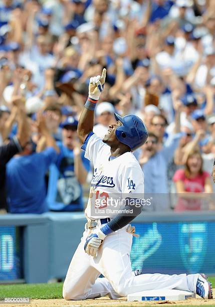 Orlando Hudson of the Los Angeles Dodgers points to the sky after hitting for the cycle with a triple in the sixth inning against the San Francisco...