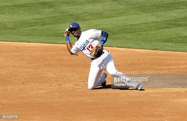 Orlando Hudson of the Los Angeles Dodgers throws out a runner against the Colorado Rockies on October 4 2009 at Dodger Stadium in Los Angeles...