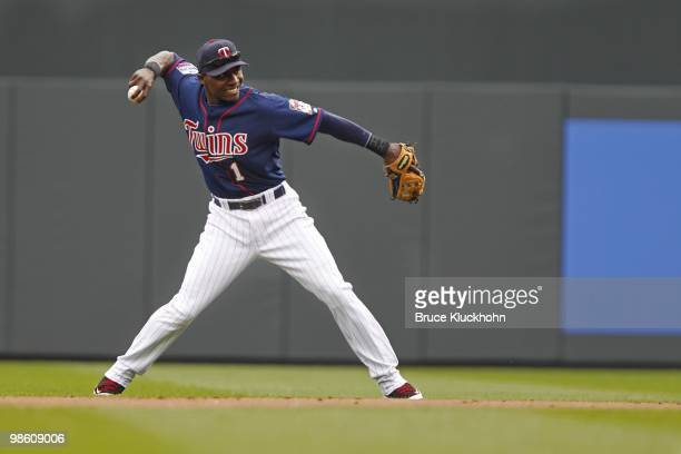 Orlando Hudson of the Minnesota Twins flelds a ball hit by the Boston Red Sox on April 14 2010 at Target Field in Minneapolis Minnesota The Red Sox...