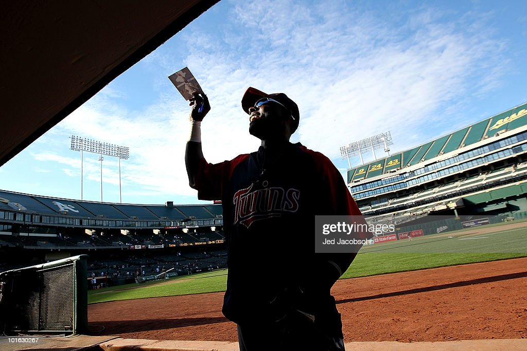 Orlando Hudson #1 of the Minnesota Twins signs autographs before a game against the Oakland Athletics at the Oakland-Alameda County Coliseum on June 4, 2010 in Oakland, California.