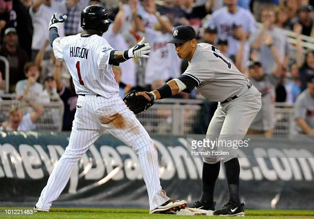 Orlando Hudson of the Minnesota Twins slides into third base safely as Alex Rodriguez of the New York Yankees applies the tag in the fifth inning...