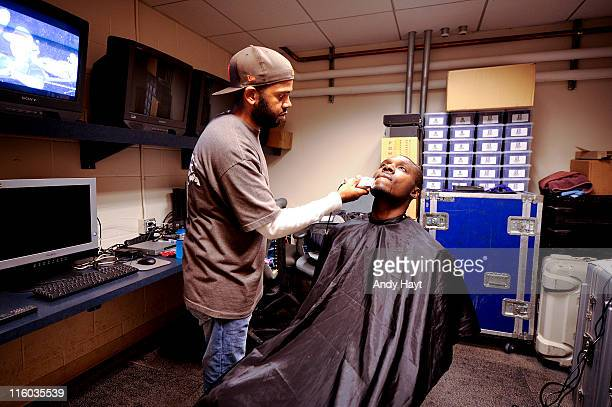 Orlando Hudson of the San Diego Padres gets a haircut in the video room in the clubhouse prior to the game against the Washington Nationals on June...