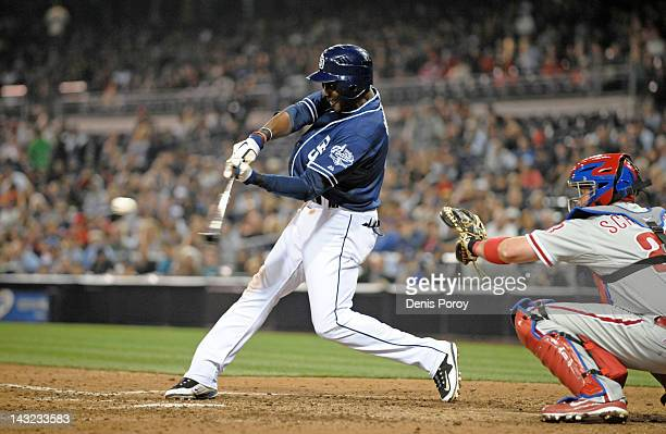 Orlando Hudson of the San Diego Padres hits an RBI triple during the eighth inning of a baseball game against the Philadelphia Phillies at Petco Park...