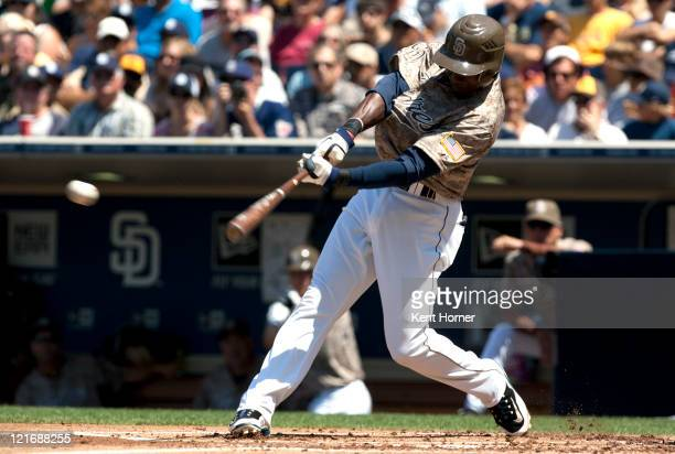 Orlando Hudson of the San Diego Padres hits the ball for a single in the first inning of the game against the Florida Marlins at Petco Park on August...