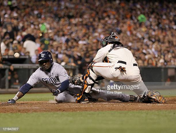 Orlando Hudson of the San Diego Padres scored when the ball got away from Chris Stewart of the San Francisco Giants in the seventh inning at ATT Park...