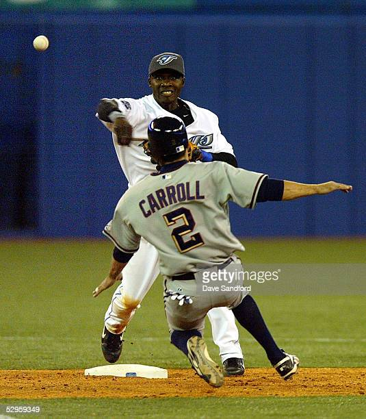 Orlando Hudson of the Toronto Blue Jays makes the play at second base to force out Jamey Carroll of the Washington Nationals during the game at...