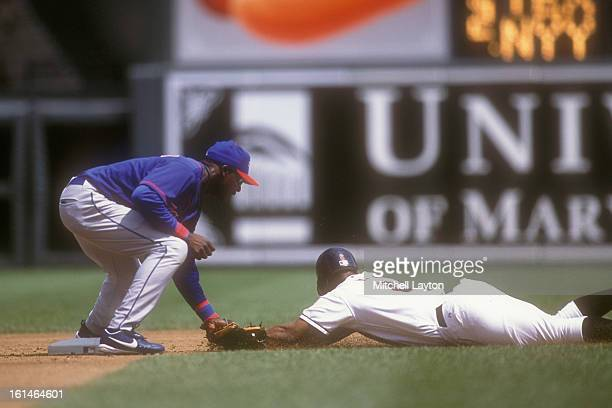 Orlando Hudson of the Toronto Blue Jays tags out Melvin Mora of the Baltimore Orioles during a baseball game on August 23 2002 at Camden Yards in...