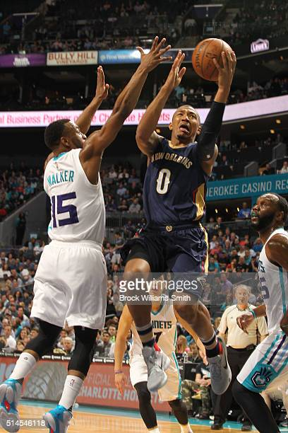 Orlando Johnson of the New Orleans Pelicans shoots against Kemba Walker of the Charlotte Hornets during the game at the Time Warner Cable Arena on...