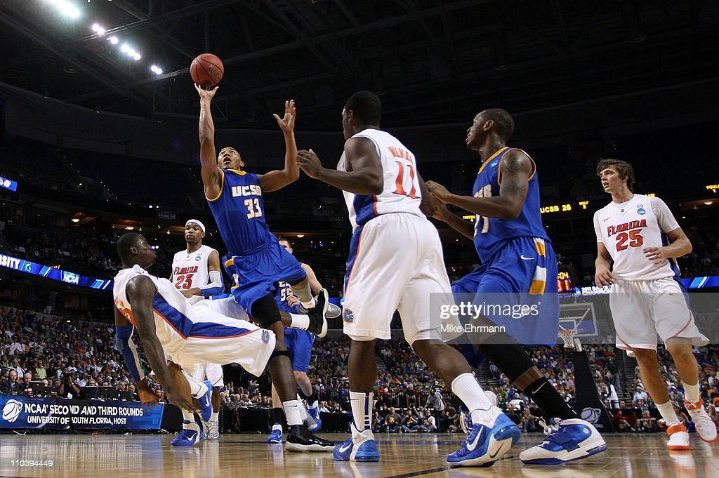 Orlando Johnson #33 of the UC Santa Barbara Gauchos drives for a shot attempt against Vernon Macklin #32 of the Florida Gators during the second round of the 2011 NCAA men's basketball tournament at St. Pete Times Forum on March 17, 2011 in Tampa, Florida.