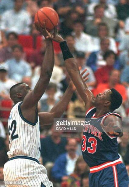 Orlando Magic center Shaquille O'Neal has his shot blocked by New York Knicks center Patrick Ewing 28 February in the first period at the Arena in...