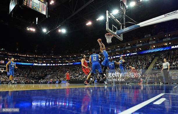 Orlando Magic Channing Fyre jumps for a basket with Orlando Magic Nikola Vucevic during the NBA Global Game London 2016 basketball match between...
