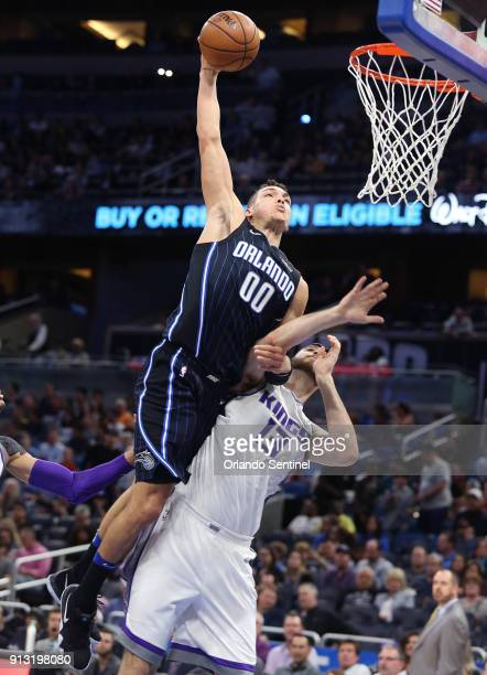 Orlando Magic forward Aaron Gordon dunks over Sacramento Kings center George Papagiannis on January 23 2018 at the Amway Center in Orlando Fla