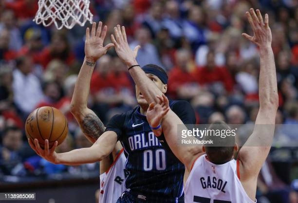 Orlando Magic forward Aaron Gordon splits the defence of Toronto Raptors guard Danny Green and Toronto Raptors center Marc Gasol Toronto Raptors vs...