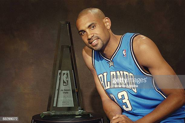 Orlando Magic forward Grant Hill poses with the Joe Dumars Trophy awarded to the winner of the 2005 NBA Sportsmanship Award at the RDV Sportsplex on...