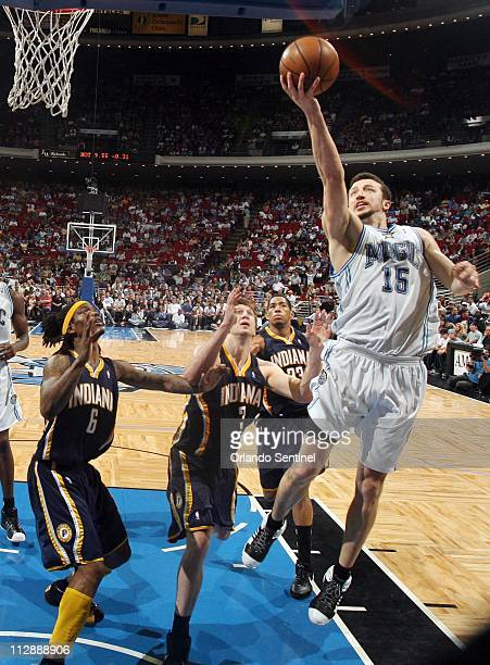 Orlando Magic forward Hedo Turkoglu puts up a score over Indiana Pacers defenders Marquis Daniels Troy Murphy and Danny Granger during game action at...