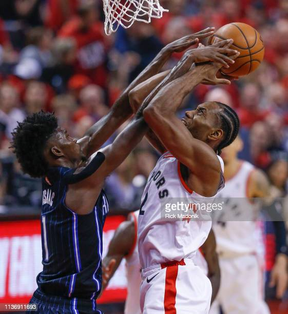 Orlando Magic forward Jonathan Isaac doesn't draw a foul as he guards Toronto Raptors forward Kawhi Leonard Toronto Raptors vs Orlando Magic in 1st...
